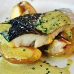 Bacalao con curry y manzana asada en restaurante Claravia del hotel Novotel